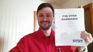 "Frank and the manuscript for ""Fog Over Mandaree"""