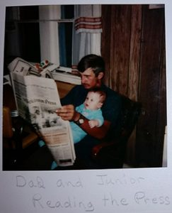 Frank and father reading newspaper